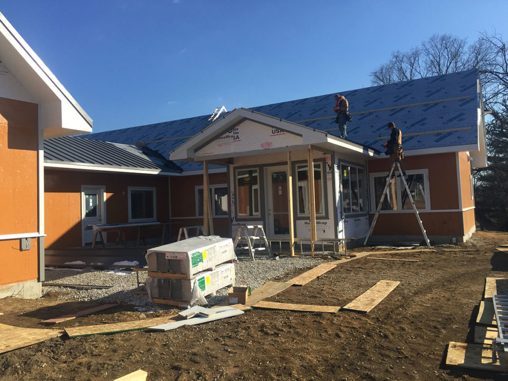 Liquid house wrap provides a seamless layer of protection to green building insulation.